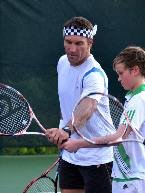 Guest being coached by tennis legend Pat Cash