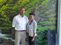 Calvert Jones and Rashida Samuel of McAllister Designs in front of one of Calvert's paintings