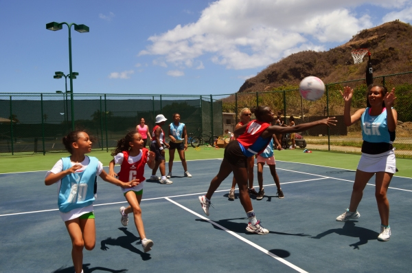 Resort guests play a match